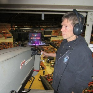 Terry Kline operating a spotlight at the Dane County Coliseum. (Photo via Facebook)